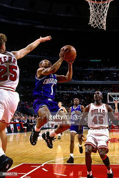 Muggsy Bogues of the Charlotte Hornets goes up for a shot against the Chicago Bulls in Game Three of the Eastern Conference Quarterfinals during the...