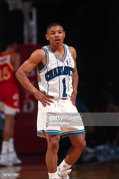Muggsy Bogues of the Charlotte Hornets looks on against the Atlanta Hawks during a game played on March 20 1992 at the Charlotte Coliseum in...