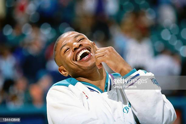 Muggsy Bogues of the Charlotte Hornets passes laughs during the game against the New York Knicks at Charlotte Coliseum on April 17 1994 in Charlotte...