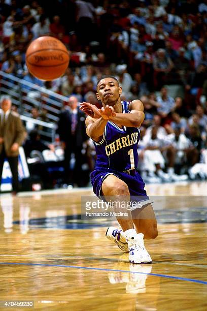 Muggsy Bogues of the Charlotte Hornets passes the ball against the Orlando Magic on March 23 1995 at the Orlando Arena in Orlando Florida NOTE TO...