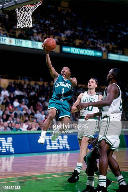 Muggsy Bogues of the Charlotte Hornets shoots a layup against the Boston Celtics during a game played circa 1994 at the Boston Garden in Boston...