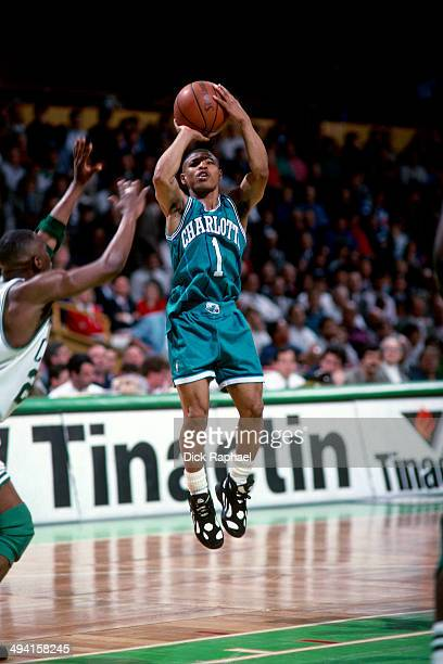 Muggsy Bogues of the Charlotte Hornets shoots against the Boston Celtics during a game played at the Boston Garden in Boston Massachusetts circa 1993...