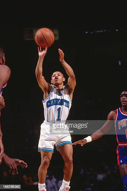Muggsy Bogues of the Charlotte Hornets shoots the ball against the Detroit Pistons during a game played on March 22 1992 at the Charlotte Coliseum in...