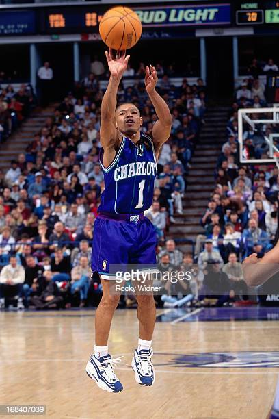 Muggsy Bogues of the Charlotte Hornets shoots the ball against the Sacramento Kings during a game played on January 12 1997 at Arco Arena in...