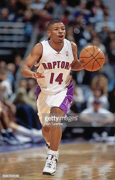 Muggsy Bogues of the Toronto Raptors drives against the Indiana Pacers on December 14 1999 at the Air Canada Centre in Toronto Ontario in Canada NOTE...