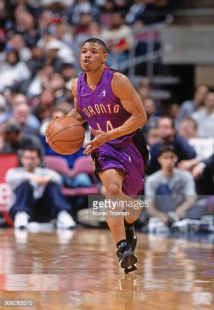 Muggsy Bogues of the Toronto Raptors drives against the New Jersey Nets on March 30 2000 at Continental Airlines Arena in East Rutherford New Jersey...