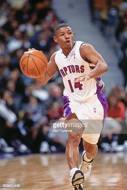 Muggsy Bogues of the Toronto Raptors drives against the Phildelphia 76ers on November 14 1999 at the Air Canada Centre in Toronto Ontario Canada NOTE...