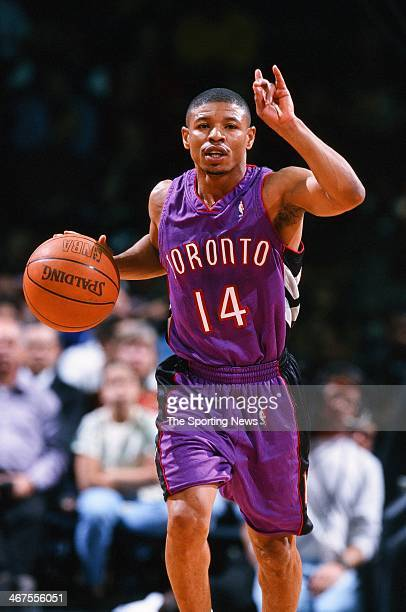 Muggsy Bogues of the Toronto Raptors moves the ball during the game against the Houston Rockets on December 28 1999 at Compaq Center in Houston Texas