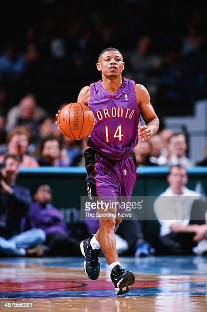 Muggsy Bogues of the Toronto Raptors moves the ball during the game against the Charlotte Hornets on January 17 2000 at Charlotte Coliseum in...