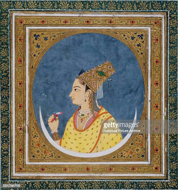 Mughal Miniature Painting Depicting a Woman with Headdress Holding a Lotus Petal