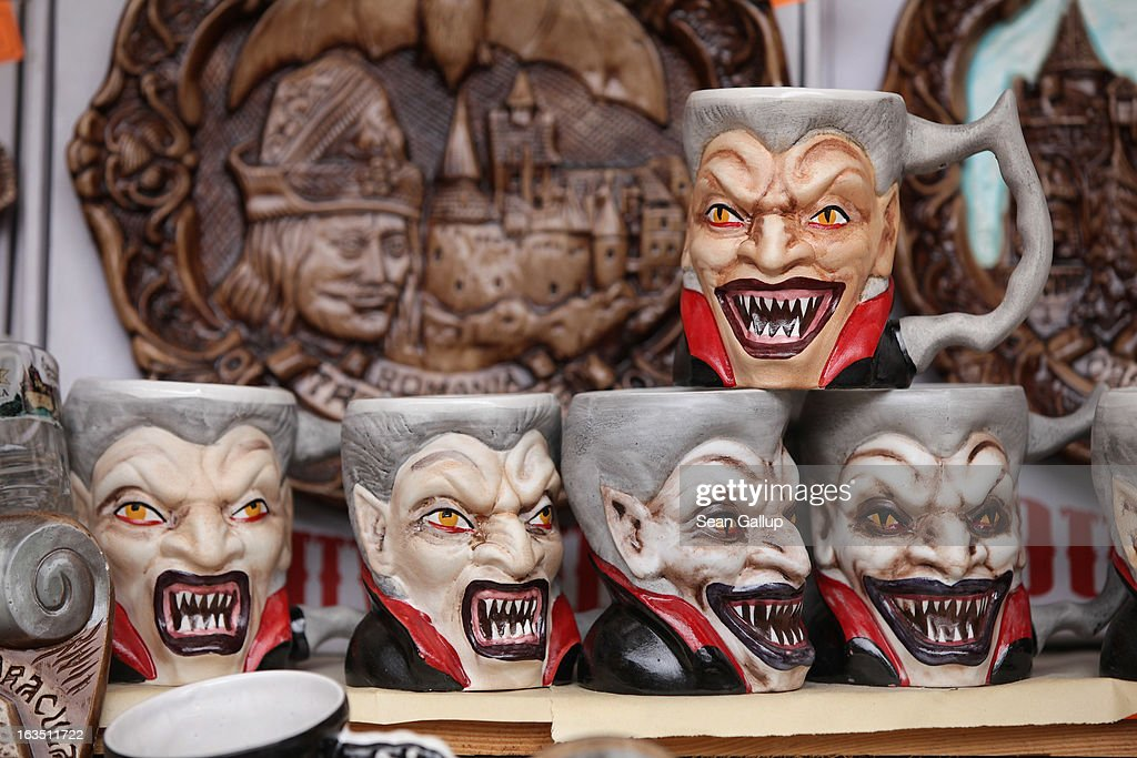 Mugs bearing a rendition of Dracula are displayed at a souvenir shop at Bran Castle, famous as 'Dracula's Castle,' on March 10, 2013 in Bran, Romania. Bran Castle's reputation as the supposed home to Dracula corresponds little with Bram Stoker's novel, nor did Vlad Tepes, the sadistic 15th-century Wallachian prince, ever live there. Nevetheless the castle retains the myth and tourists flock there in large numbers. Bran Castle, along with the mountainous region of southern Transylvania, which is home to Saxon fortified towns and churches, are among the asssets the Romanian government hopes will bring increasing numbers of tourists to the country. Both Romania and Bulgaria have been members of the European Union since 2007 and restrictions on their citizens' right to work within the EU are scheduled to end by the end of this year. However Germany's interior minister announced recently that he would veto the two countries' entry into the Schengen Agreement, which would not affect labour rights but would prevent passport-free travel.