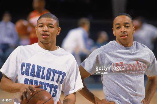 Mugsy Bogues of the Charlotte Hornets stands on the court with Spud Webb of the Atlanta Hawks before an NBA game at Charlotte Colesium in 1989