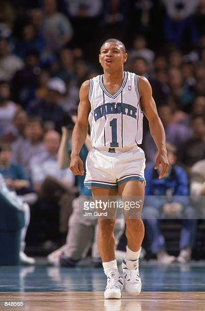 Mugsy Bogues of the Charlotte Hornets walks on the court during an NBA game at Charlotte Colesium in 1989