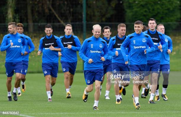 Muhamed Besic and Davy Klaassen warm up with teammates during the Everton FC training session at USM Finch Farm on September 7 2017 in Halewood...