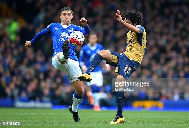 Muhamed Besic of Everton and Mohamed Elneny of Arsenal compete for the ball during the Barclays Premier League match between Everton and Arsenal at...