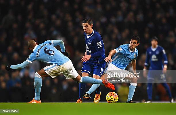 Muhamed Besic of Everton competes for the ball against Fernando and Jesus Navas of Manchester City during the Barclays Premier League match between...