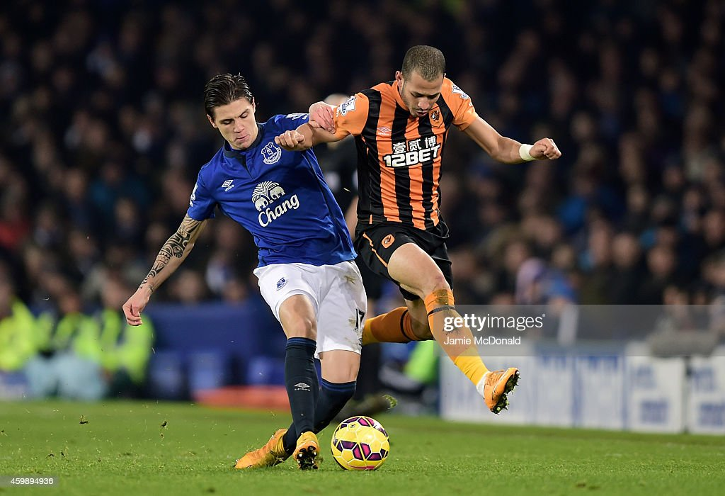 Muhamed Besic of Everton is challenged by Liam Rosenior of Hull City during the Barclays Premier League match between Everton and Hull City at Goodison Park on December 3, 2014 in Liverpool, England.