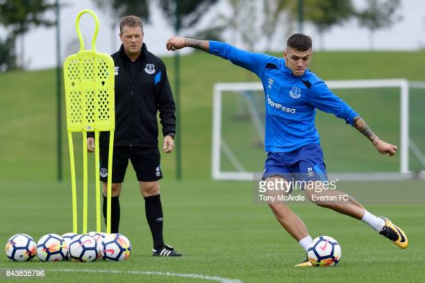 Muhamed Besic of Everton is watched by assistant coach Erwin Koeman during the Everton FC training session at USM Finch Farm on September 7 2017 in...