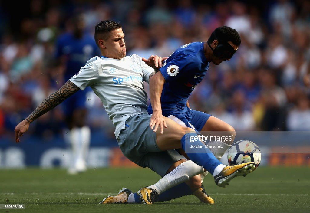 Muhamed Besic of Everton tackles Pedro of Chelsea during the Premier League match between Chelsea and Everton at Stamford Bridge on August 27, 2017 in London, England.