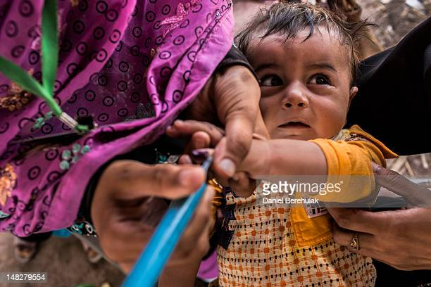 Muhammad 12 months is held by his mother displaced from her home due to the Pakistan Army's latest Military offensive in the Bara area of Khyber...