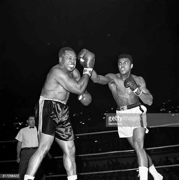 Muhammad Ali and Archie Moore boxing in a World Heavyweight title elimination match
