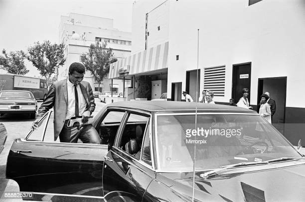 Muhammad Ali getting back into his car after meeting some of his fans 31st August 1967