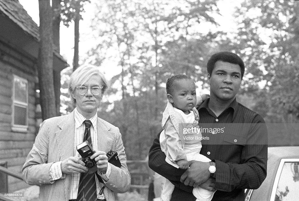 Muhammad Ali, Hana Ali and Andy Warhol in Deer Lake, Pennsylvania, where Ali set up his training camp.