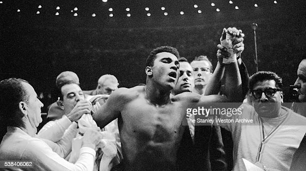 Muhammad Ali has his hand raised to signify the win aginst Archie Moore during the fight at the Sports Arena on November 15 1962 in Los Angeles...
