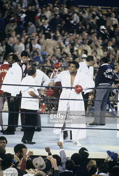 Muhammad Ali in the white robe excites the crowd before a heavyweight fight against Ken Norton September 28 1976 at Yankee Stadium in Bronx New York