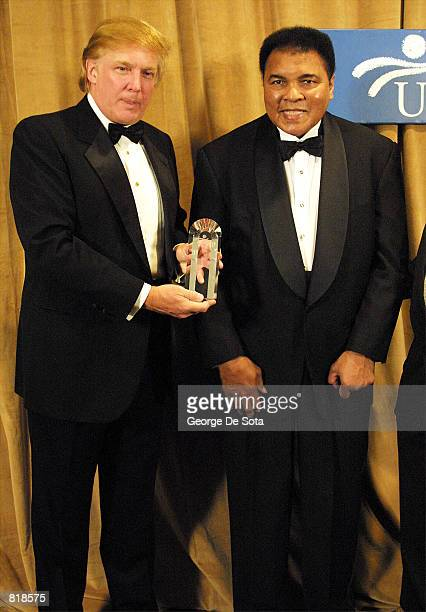 Muhammad Ali is honored March 14 2001 and receives The UCP's Humanitarian Award from Donald Trump at the United Cerebral Palsey dinner at the New...