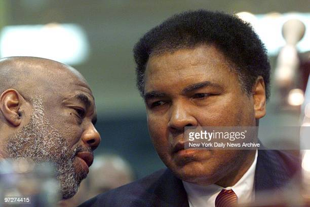 Muhammad Ali listens to Howard Bingham during a Senate Commerce Committee hearing on the Boxing Reform Act Bingham read testimony of Ali whose speech...