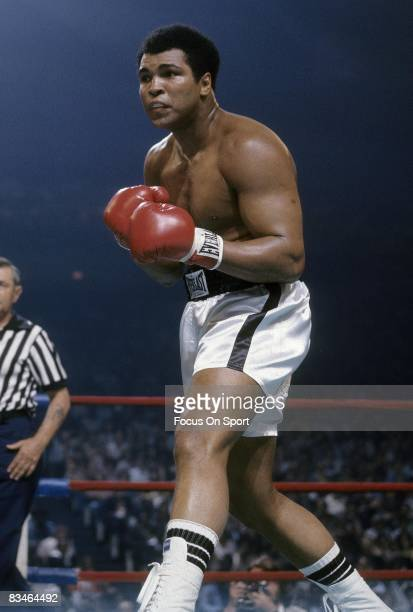 Muhammad Ali looks for an opening against Alfredo Evangelista not pictured during a WBC/WBA heavyweight championship fight on May 16 1977 at the...
