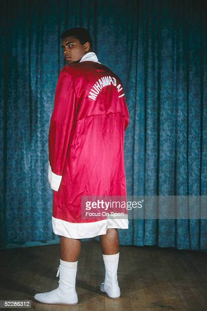 Muhammad Ali poses a portrait in his robe in 1964