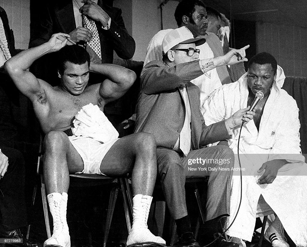 <a gi-track='captionPersonalityLinkClicked' href=/galleries/search?phrase=Muhammad+Ali+-+Boxer+-+Born+1942&family=editorial&specificpeople=93853 ng-click='$event.stopPropagation()'>Muhammad Ali</a> primps for the camera during a postfight interview as Joe Frazier states, 'I want him again.' Ali won the NABF heavyweight crrown in 12 rounds.