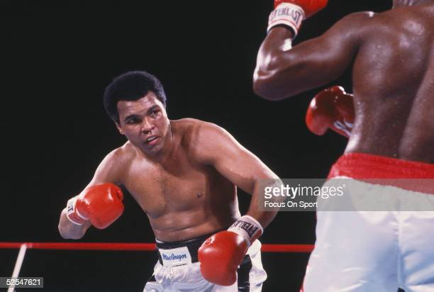 Muhammad Ali takes aim at his opponent during a boxing match