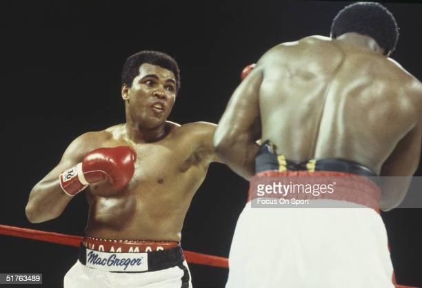 Muhammad Ali throws a left hook at Trevor Berbick at the Queen Elizabeth Sports Centre on December 11 1981 in Nassau Bahamas Berbick defeated Ali in...
