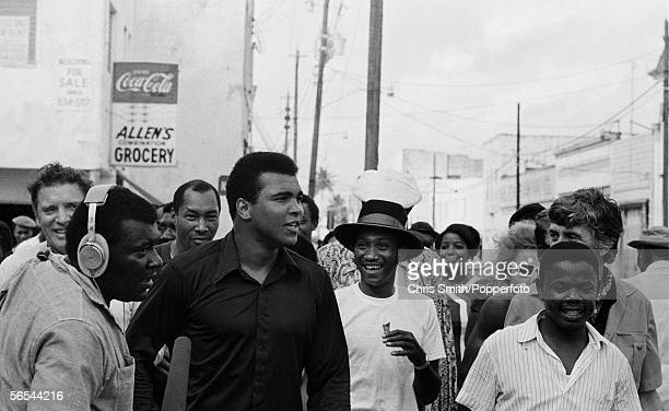 Muhammad Ali visiting a black ghetto with Burt Lancaster whilst training in Miami Beach circa February 1971 Photo by Chris Smith/Popperfoto/Getty...