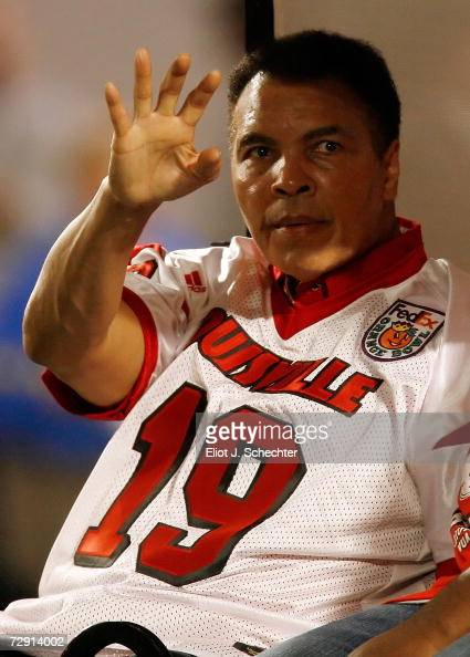 Muhammad Ali waves to the crowd before the 2007 FedEx Orange Bowl between the Louisville Cardinals and the Wake Forest Demon Deacons at Dolphin...