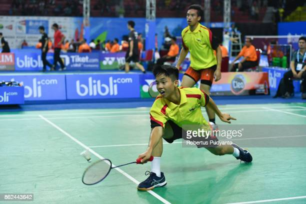 Muhammad Hadi Haji Bakri and Jian Shyan Lee of Brunei Darussalam compete against Thom Gicquel and Leo Rossi of France during Men's Doubles...