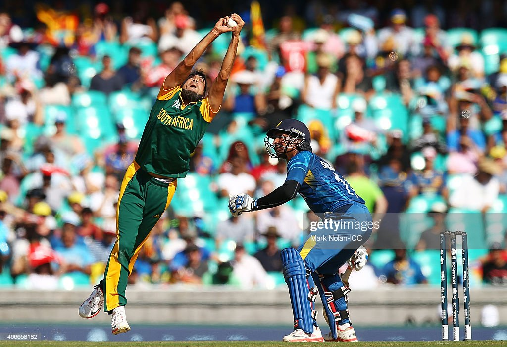 Muhammad Imran Tahir of South Africa takes a catch off his own bowling to dimiss Lahiru Thirimanna of Sri Lanka during the 2015 ICC Cricket World Cup match between South Africa and Sri Lanka at Sydney Cricket Ground on March 18, 2015 in Sydney, Australia.