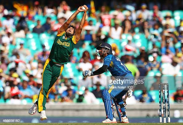 Muhammad Imran Tahir of South Africa takes a catch off his own bowling to dimiss Lahiru Thirimanna of Sri Lanka during the 2015 ICC Cricket World Cup...