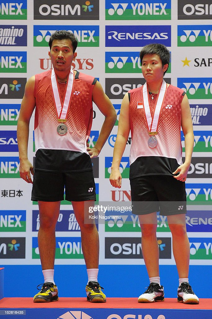 Muhammad Rijal and <a gi-track='captionPersonalityLinkClicked' href=/galleries/search?phrase=Liliyana&family=editorial&specificpeople=4055313 ng-click='$event.stopPropagation()'>Liliyana</a> Natsir of Indonesia stand on the podium after losing the meixed doubles final match against Peng Soon Chan and Liu Ying Goh of Malaysia during day five of the Yonex Open Japan 2012 at Yoyogi Gymnasium on September 23, 2012 in Tokyo, Japan.