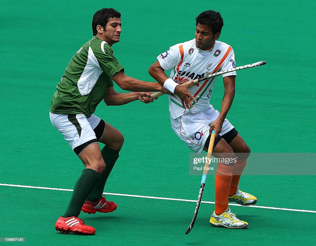 Muhammad Rizwan of Pakistan tackles Abdul Haseem Khan of India in the mens India v Pakistan game during day three of the 2012 International Super Series at Perth Hockey Stadium on November 24, 2012 in Perth, Australia.