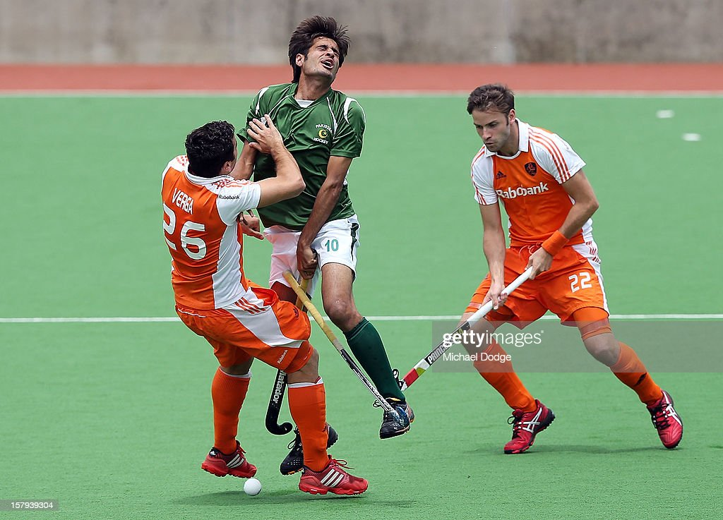 Muhammad Rizwan Senior (R) of Pakistan and Valentin Verga of The Netherlands collide in the match between Pakistan and The Netherlands during day five of the 2012 Champions Trophy at the State Netball and Hockey Centre on December 8, 2012 in Melbourne, Australia.
