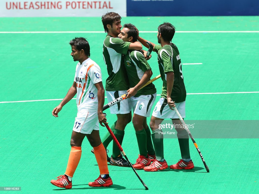 Muhammad Rizwan sr., Rashid Mahmood and Abdul Haseem Khan of Pakistan celebrate a goal as Danish Mujtaba of India walks past during day four of the 2012 International Super Series at Perth Hockey Stadium on November 25, 2012 in Perth, Australia.