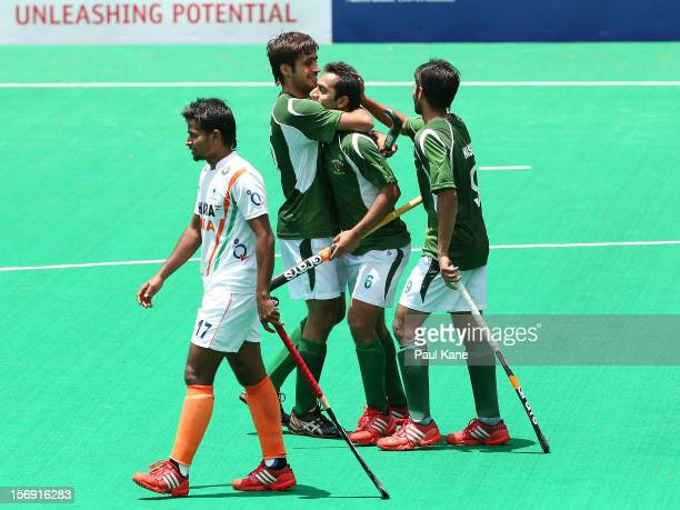 Muhammad Rizwan sr Rashid Mahmood and Abdul Haseem Khan of Pakistan celebrate a goal as Danish Mujtaba of India walks past during day four of the...