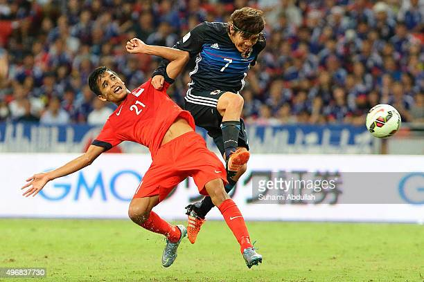 Muhammad Safuwan Bin Baharudin of Singapore and Kashiwagi Yosuke of Japan challenge for the ball during the 2018 FIFA World Cup Qualifier match...