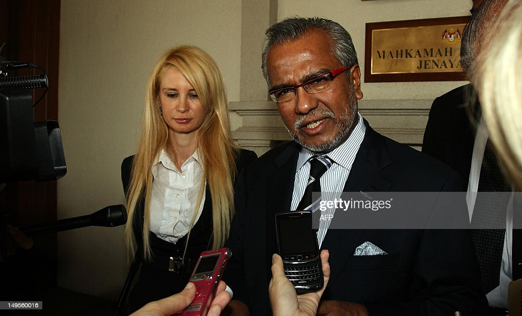 Muhammad Shafee Abdullah (R) and Tania Scivetti (L), lawyers for Emma Louise L'aiguille, an Australian woman charged with trafficking methamphetamines, speak during a press conference at the High Court in Kuala Lumpur on July 31, 2012. L'Aiguille, 34, of Melbourne, was charged in a Kuala Lumpur court along with Anthony Esikalam Ndidi of Nigeria two weeks after police said they were arrested allegedly in possession of one kilogramme (2.2 pounds) of methamphetamine. AFP PHOTO / Mohd RASFAN