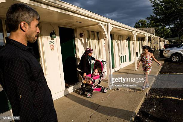 Muhammad Tanbal and his family outside their hotel on July 23 a day after arriving in the Unites States on July 22 Madison Heights Michigan The...