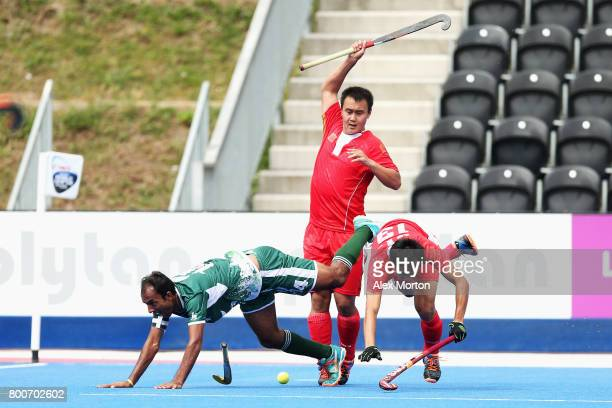 Muhammad Umar Bhutta of Pakistan Wei Wo of China and Fenghui Lu of China battle for possession during the 7th/8th place match between Pakistan and...